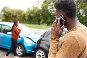 male and female motorist in auto accident